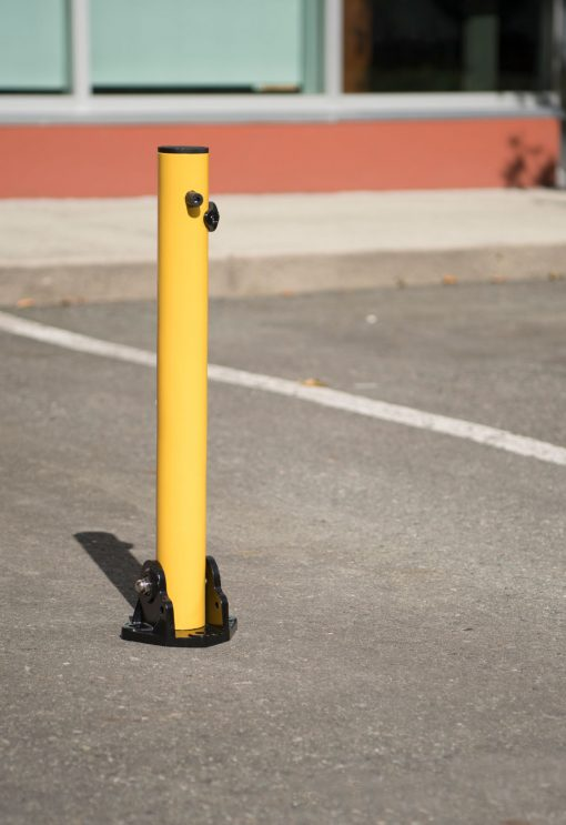 R-8430 collapsible bollard in parking lot