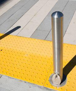 R-8902 stainless steel bollard on yellow speed hump