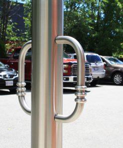 R-8903 stainless steel bike bollard in parking lot