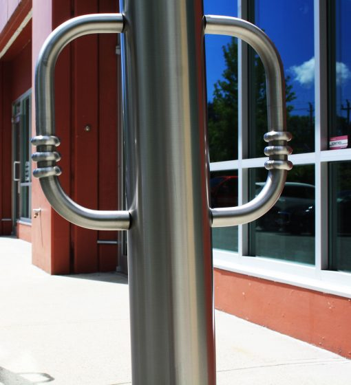 R-8903 stainless steel bollard in front of building
