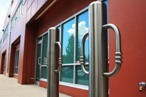 Two R-8904 stainless steel bike bollards in front of building