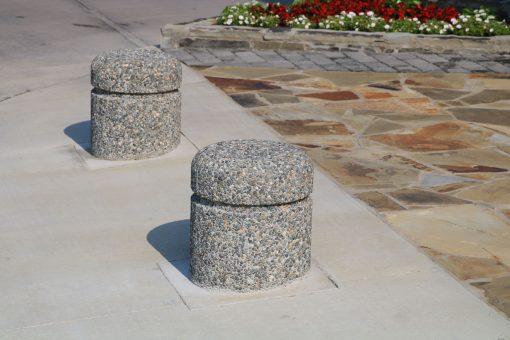 R-9701 concrete bollards on street