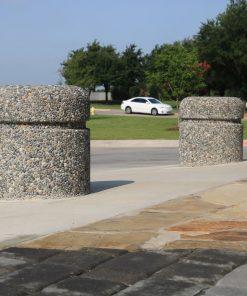 Two R-9701 concrete bollards