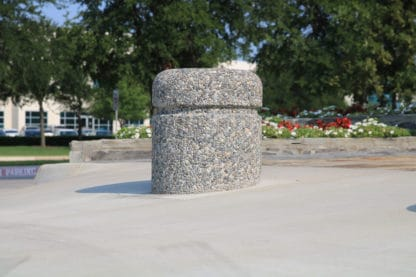 R-9701 concrete bollard on street