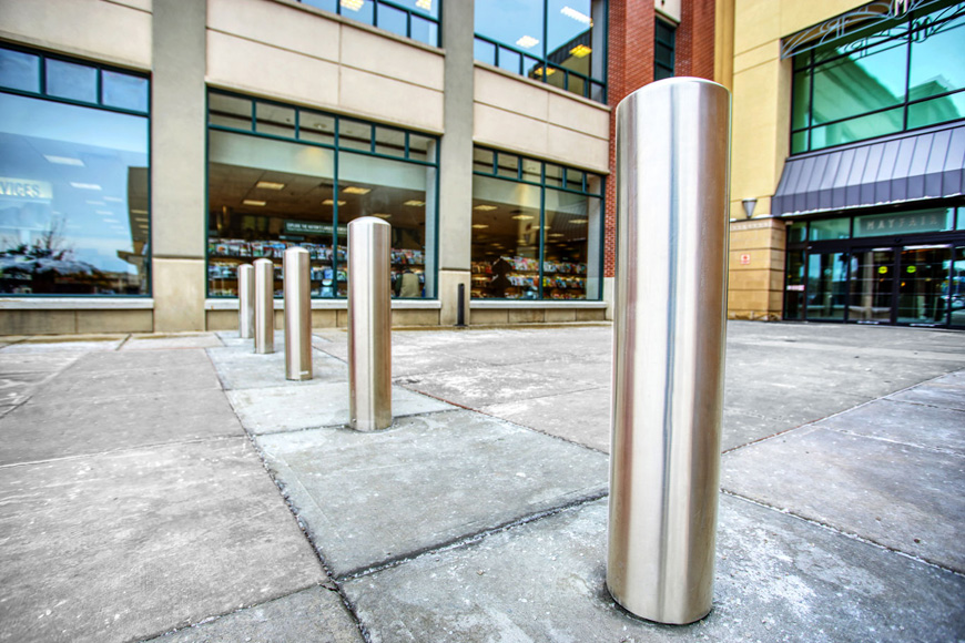 Round-top stainless steel bollard covers in plaza