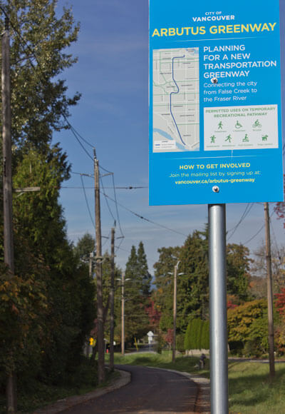 Blue sign overlooking the Arbutus Greenway, Vancouver