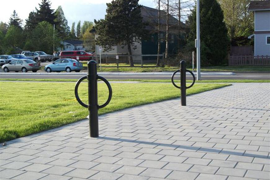 Black bike bollards installed at a park