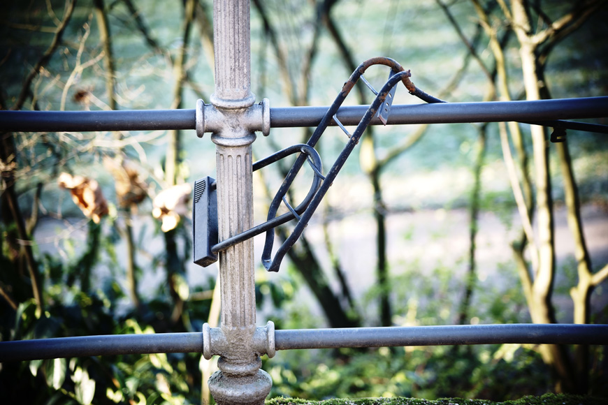 A luggage rack is left chained to a fence after a thief collected the bike