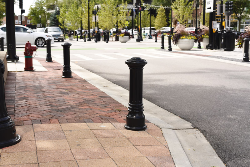 Classically shaped bollards line an attractive town square