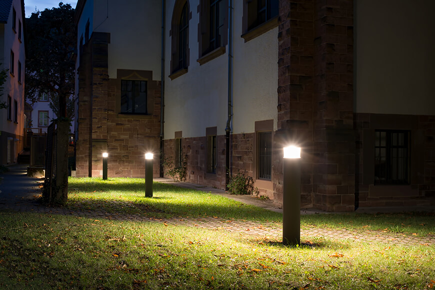Lighting bollards outside building