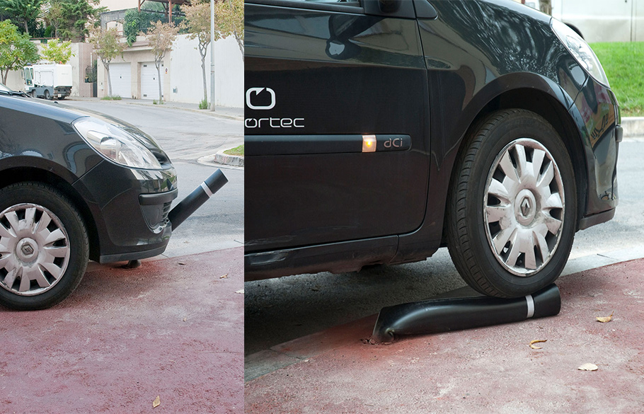A black vehicle running over a polyurethane bendable post