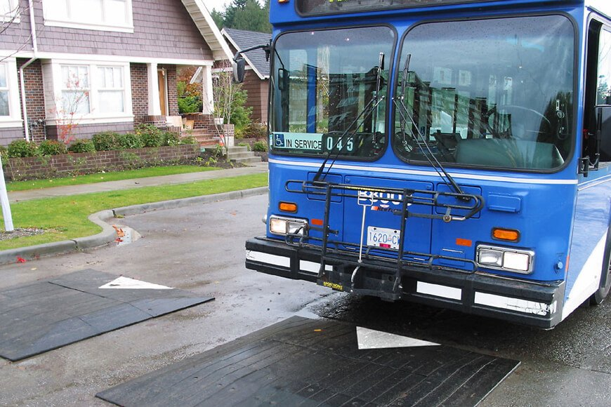 A bus travels over a speed cushion