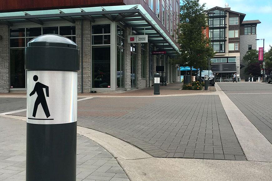Bollards mark pedestrian corners in campus village