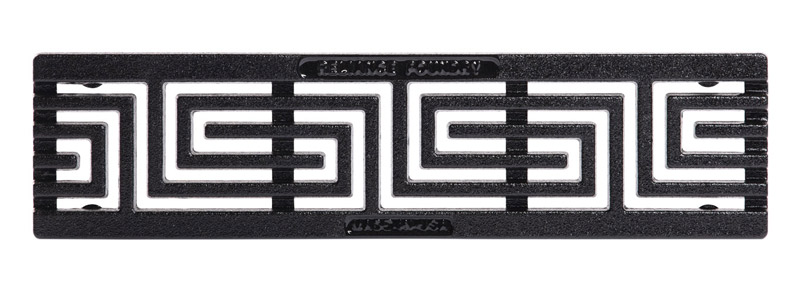 A cast iron 6-inch trench grate with slots in the shape of Greek keys.