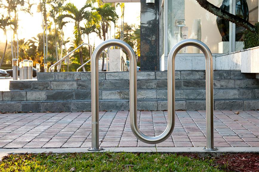 Commercial bike rack installed strategically by a sidewalk