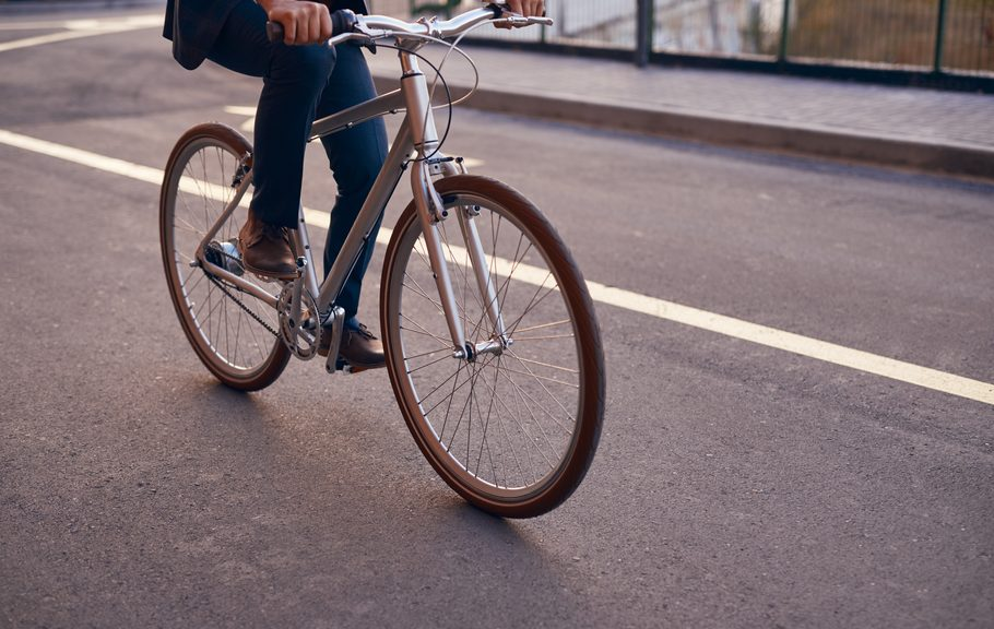 A man commutes to work on a bicycle