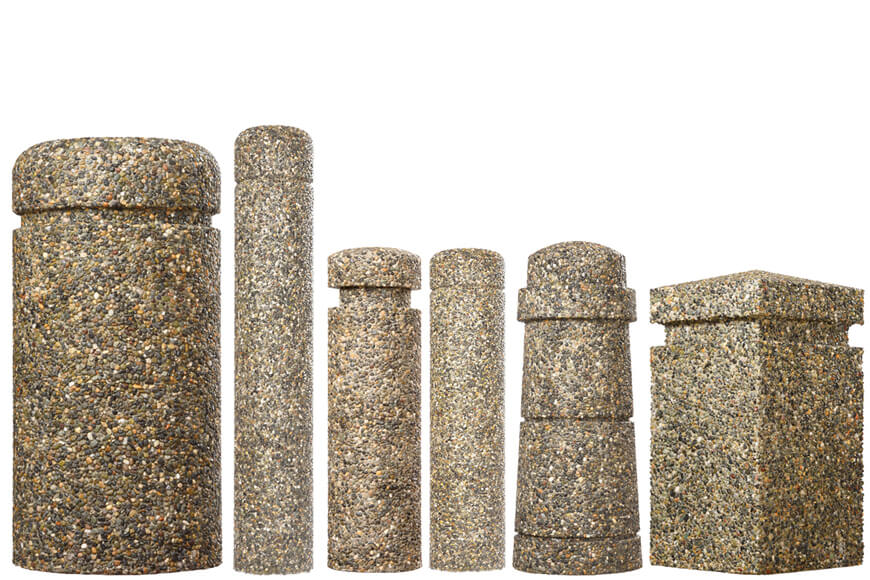 different decorative concrete bollards with exposed aggregate surface finishes in a line