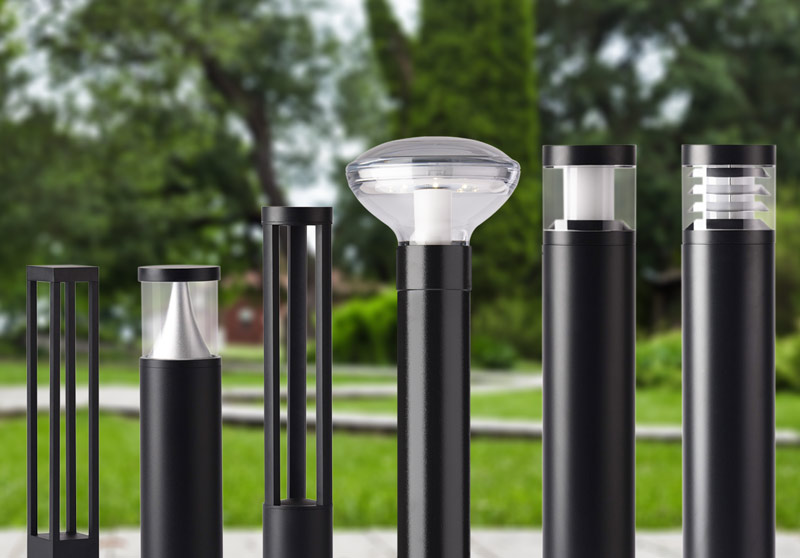 Studio shots of lighting bollards in black and white superimposed on a parkland background