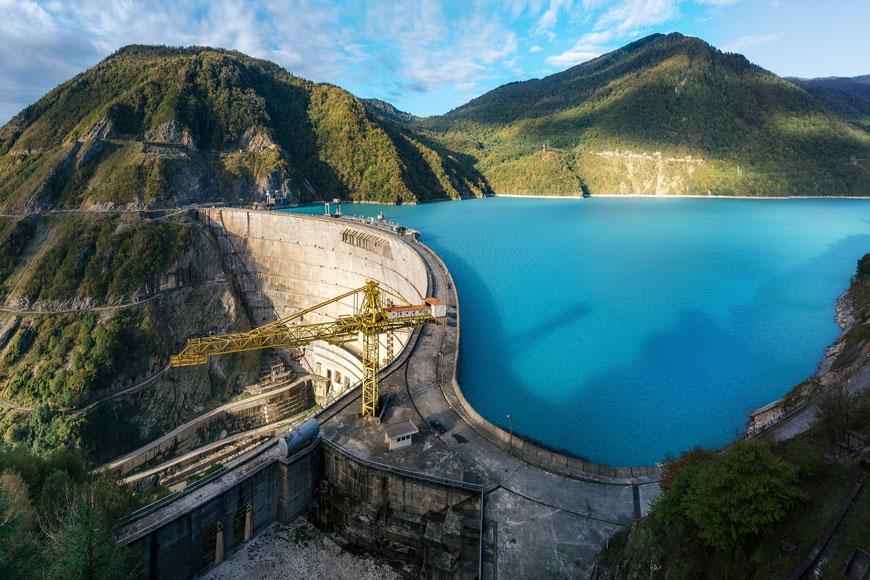 Concrete dam encompassing turquoise waters
