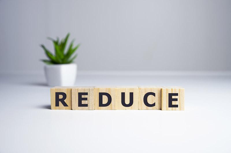"An image of wooden blocks saying ""reduce"""