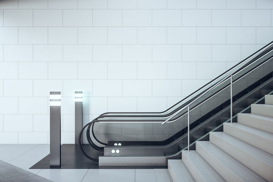 Glowing lit escalator bollards provide wayfinding and guide people into a gentle approach.