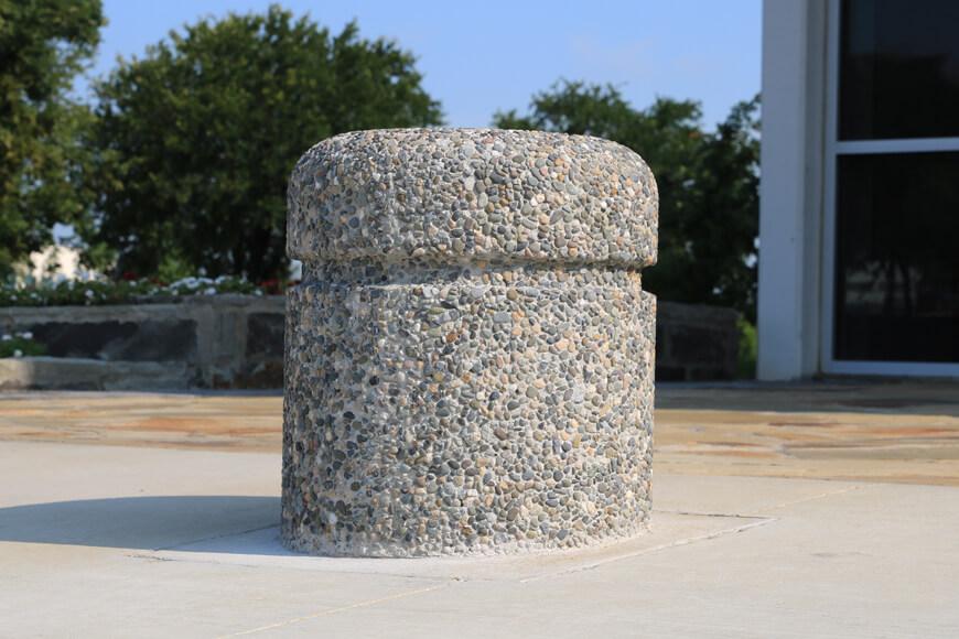 Exposed aggregate concrete on precast concrete safety bollard