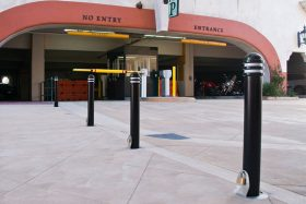Fabricated bollards placed in a row in front of an underground parking entrance
