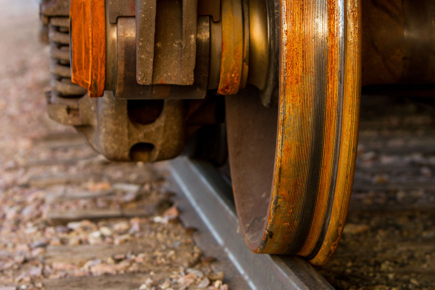 Train with single flanged track wheels on railroad