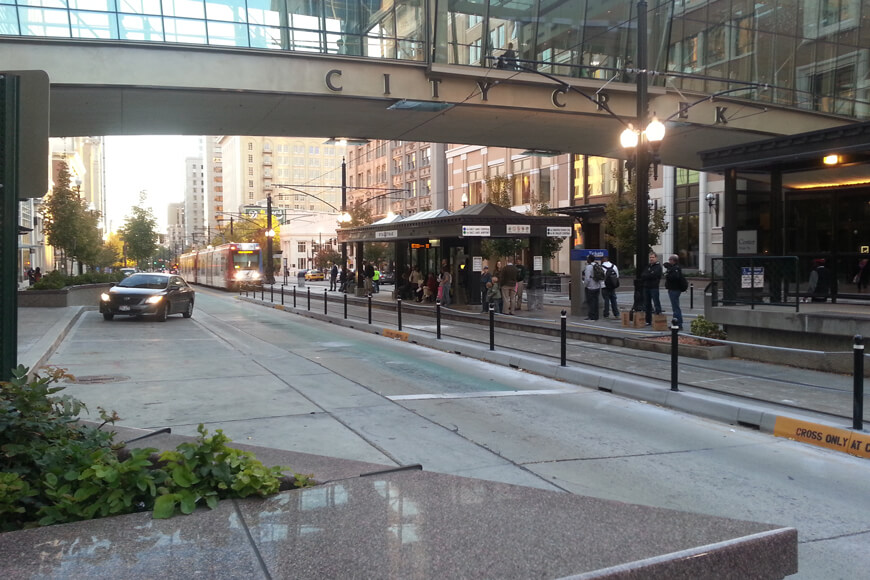 Several closely spaced bollards separate traffic from pedestrians
