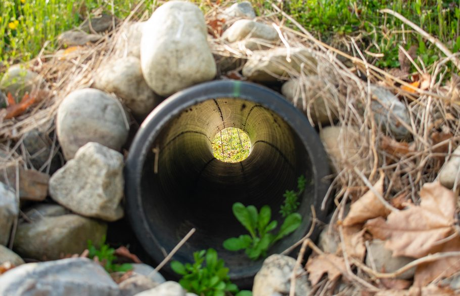 Picture through a perforated pipe surrounded by gravel.
