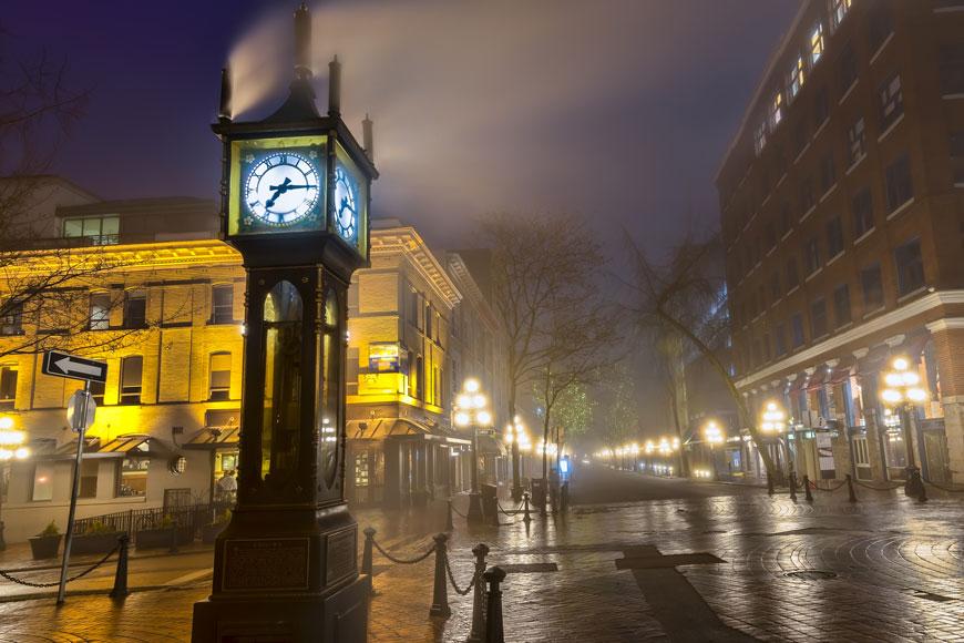 Cast iron bollards surround a steam clock in Gastown