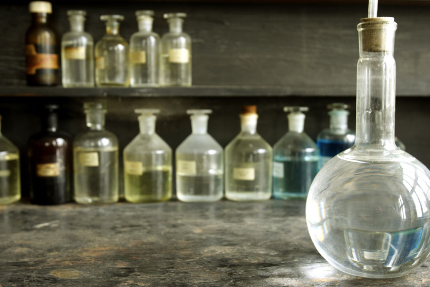 An old laboratory displays beakers filled with colorful liquids