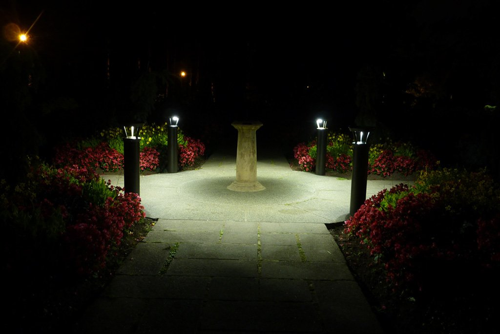 solar lighting bollards light the corners of an intersection of two paths