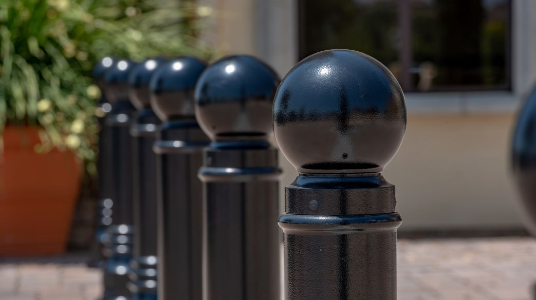 A series of black cast iron bollards created from a traditional pattern