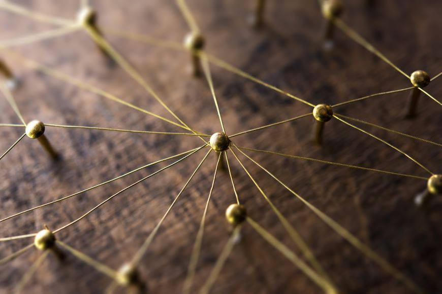 A pin and thread board visualizes a network