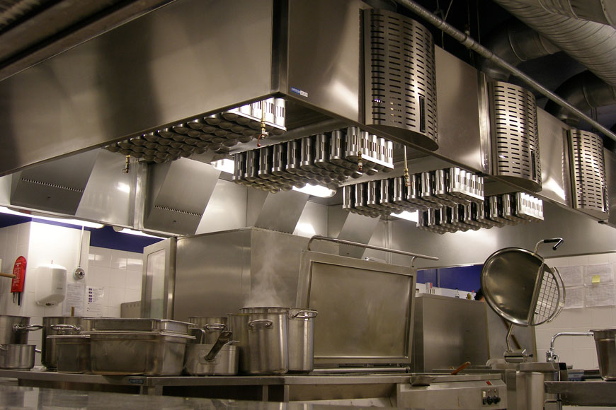 A kitchen full of stainless steel surfaces and utensils looks clean and sterilized