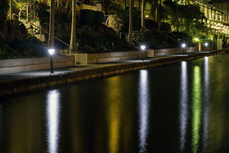 Solar bollard lights along a pathway
