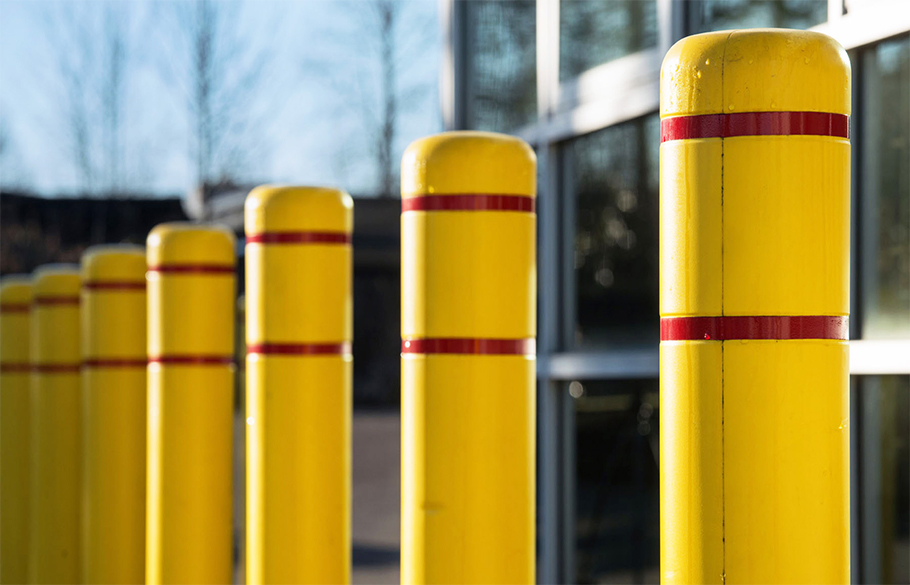 A row of bollards fitted with Reliance Foundry's plastic post covers