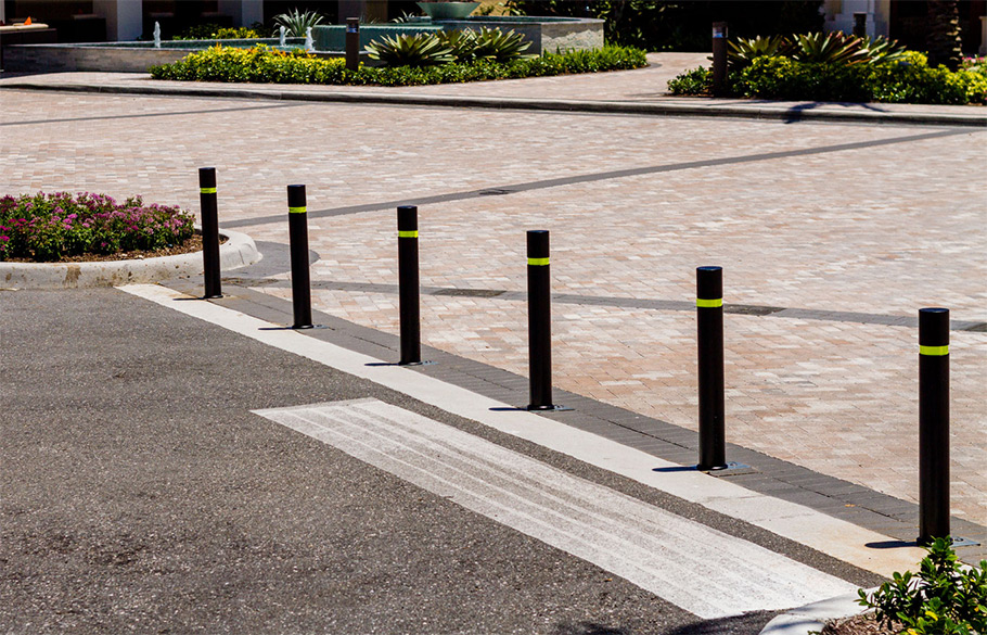 A row of Reliance Foundry bendable bollards installed by an entrance