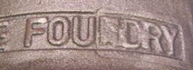 The word DIGITAL is cast into metal. The first three letters are blurred due to casting problems.