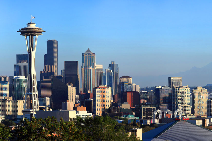 A panorama of Seattle's downtown showing the space needle and Mt. Rainier