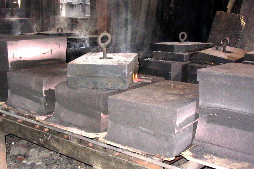 Sand casting molds awaiting shakeout after casting