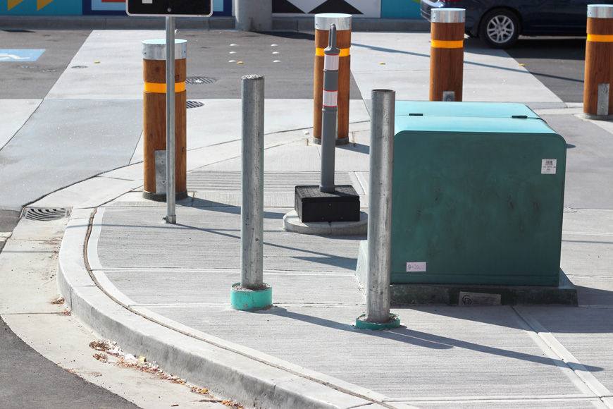 steel pipe posts protect a pad-mounted transformer