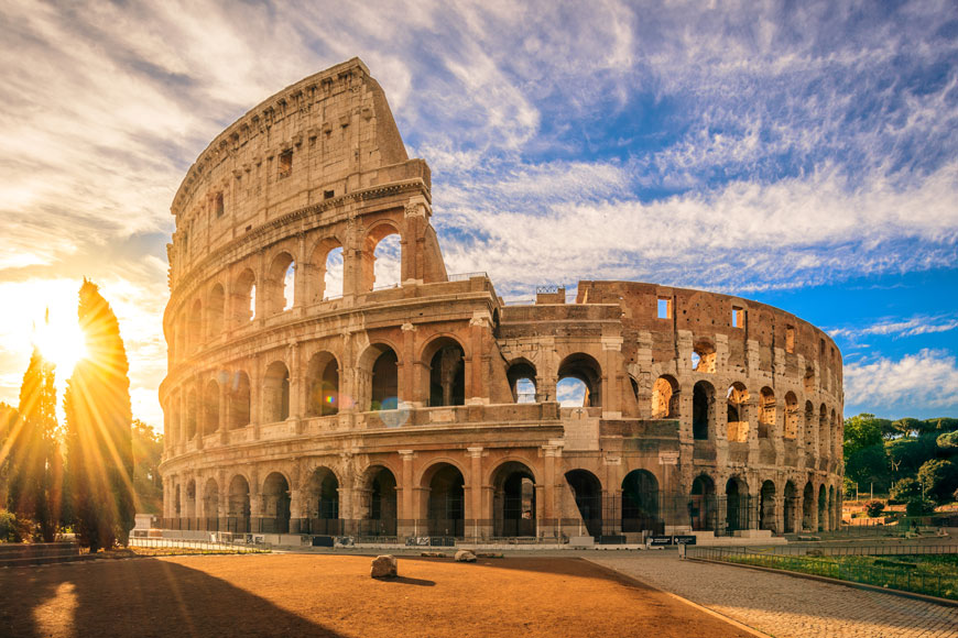 The restored Roman Colosseum at sunrise