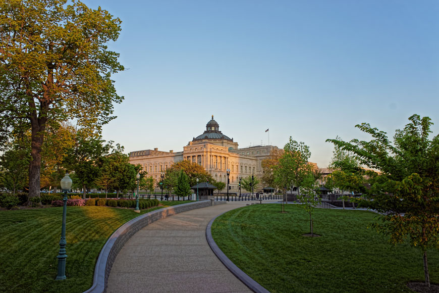 A road leading to the Library of Congress is surrounded by greenspace and protected by bollards