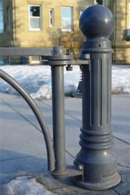 Reliance Foundry bollard custom-mounted with swing gate at Central Memorial Park