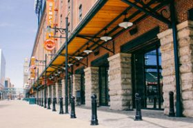 A row of Reliance Foundry's model R-7539 bollards stands outside the Oriole Store at Oriole park at Camden Yards.