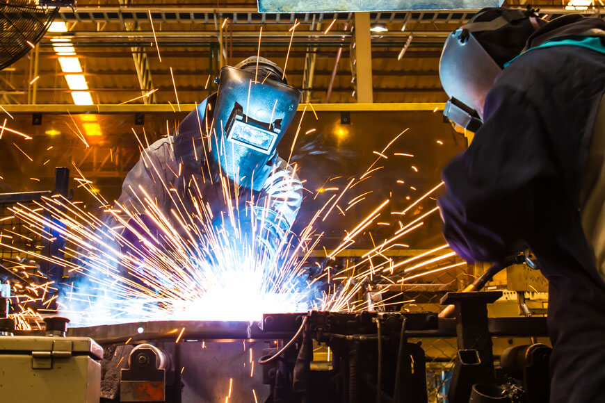 Workers weld prototype automotive fabrications