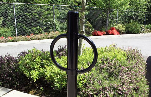 bike parking arms on black bollard in garden