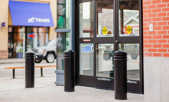 black parking bollards in front of store